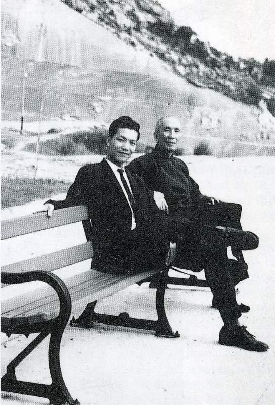 Ip Chin and Ip Man on a bench