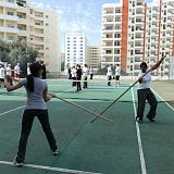girls practice wing chun pole sparring