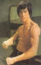 Bruce Lee showing off lean muscle