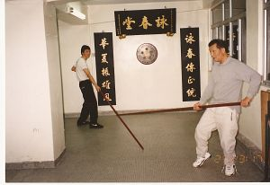 Sam Kwok and Ip Chig practice the Wing Chun pole form